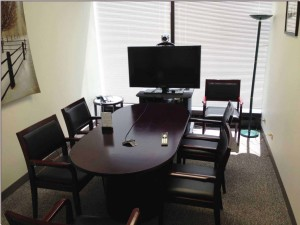 Free deposition suites in our medium-sized conference room. Video conference configuration shown.