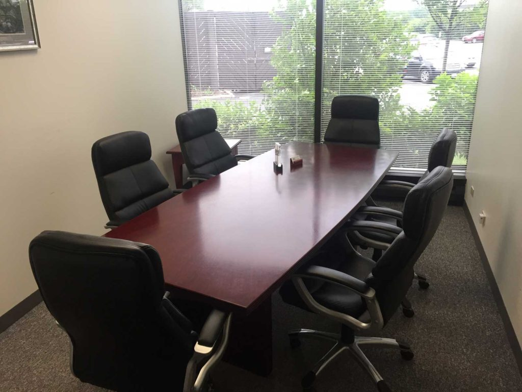 Conference room seating up to six at Lake Cook Reporting, court reporters and more in Chicago, IL.