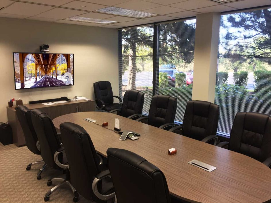 10-person conference room at Lake Cook Reporting. Our built-in video conference system and 60-inch HDTV is perfect for interviews, meetings, depositions, and more over video conference.