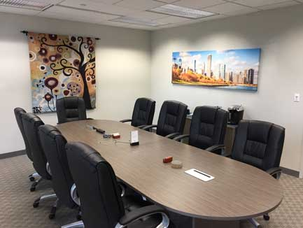 10-person conference room at Lake Cook Reporting facing our panoramic Chicago skyline and tapestry.